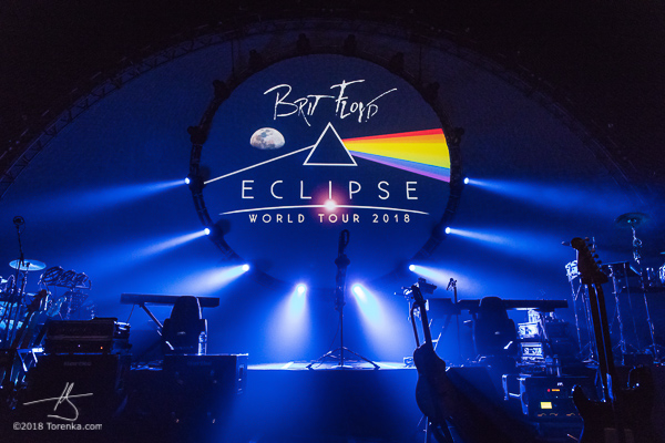 Brit Floyd pre-concert stage photo in Phoenix, AZ.  Blue lighting and the Brit Floyd logo is in the background with guitars arranged on the stage.