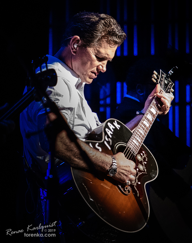 Chris Isaak playing guitar at Ikeda Theater in Mesa, Arizona.