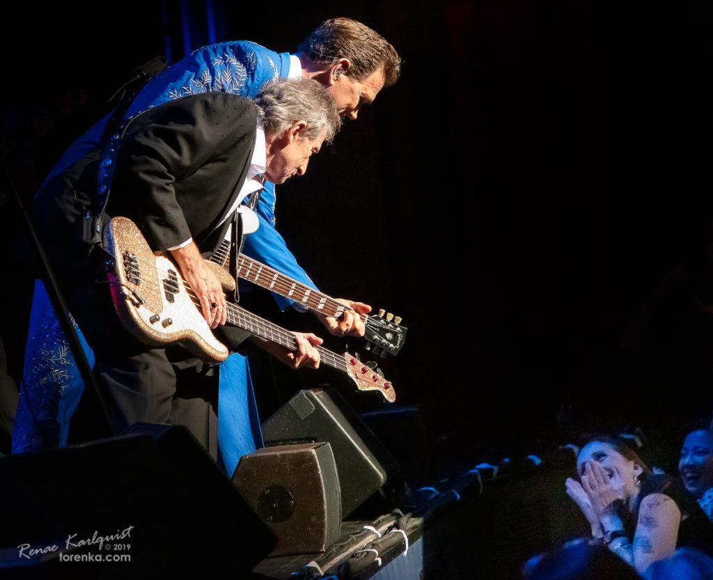 Rowland Salley playing bass and Chris Isaak playing guitar at Ikeda Theater in Mesa, Arizona.