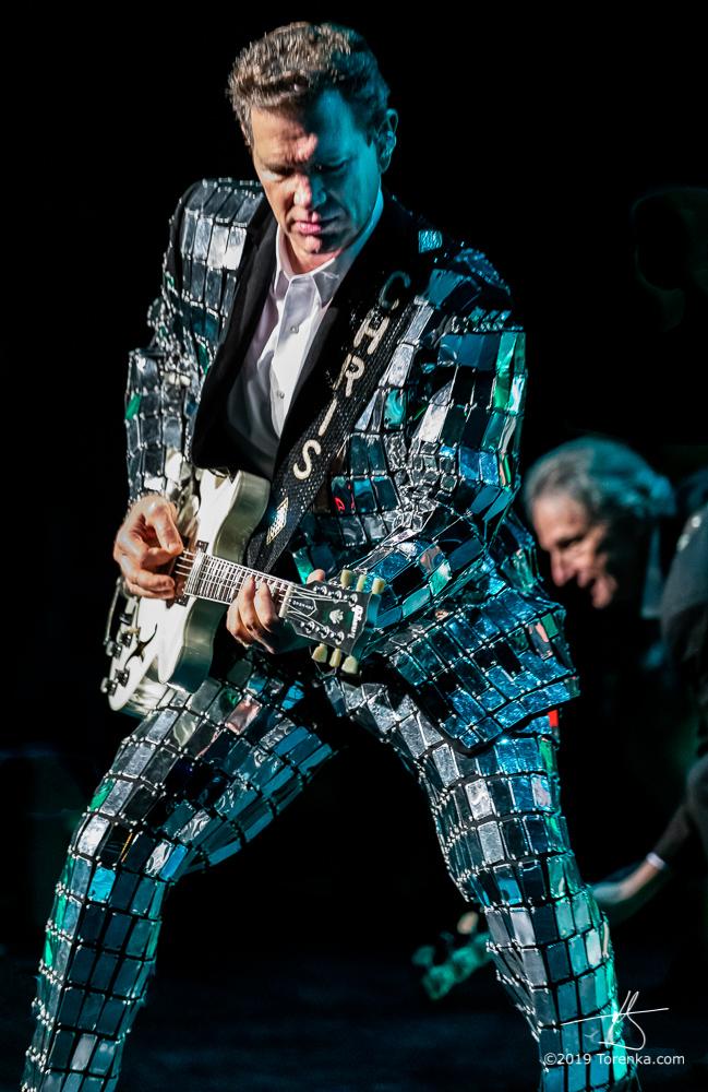 Photo of Chris Isaak playing guitar at Ikeda Theater in Mesa, Arizona